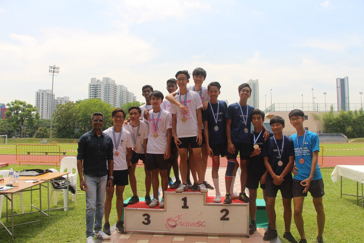 sec 45 4by100m relay winners with mr michael.jpg