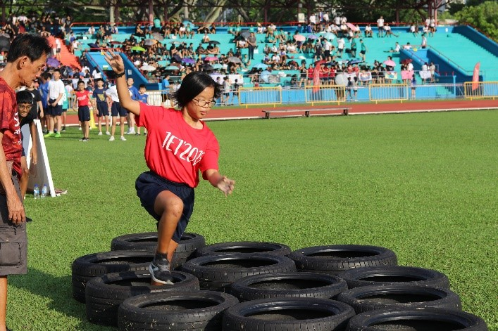 students attempting to complete the obstacle course 2.jpg